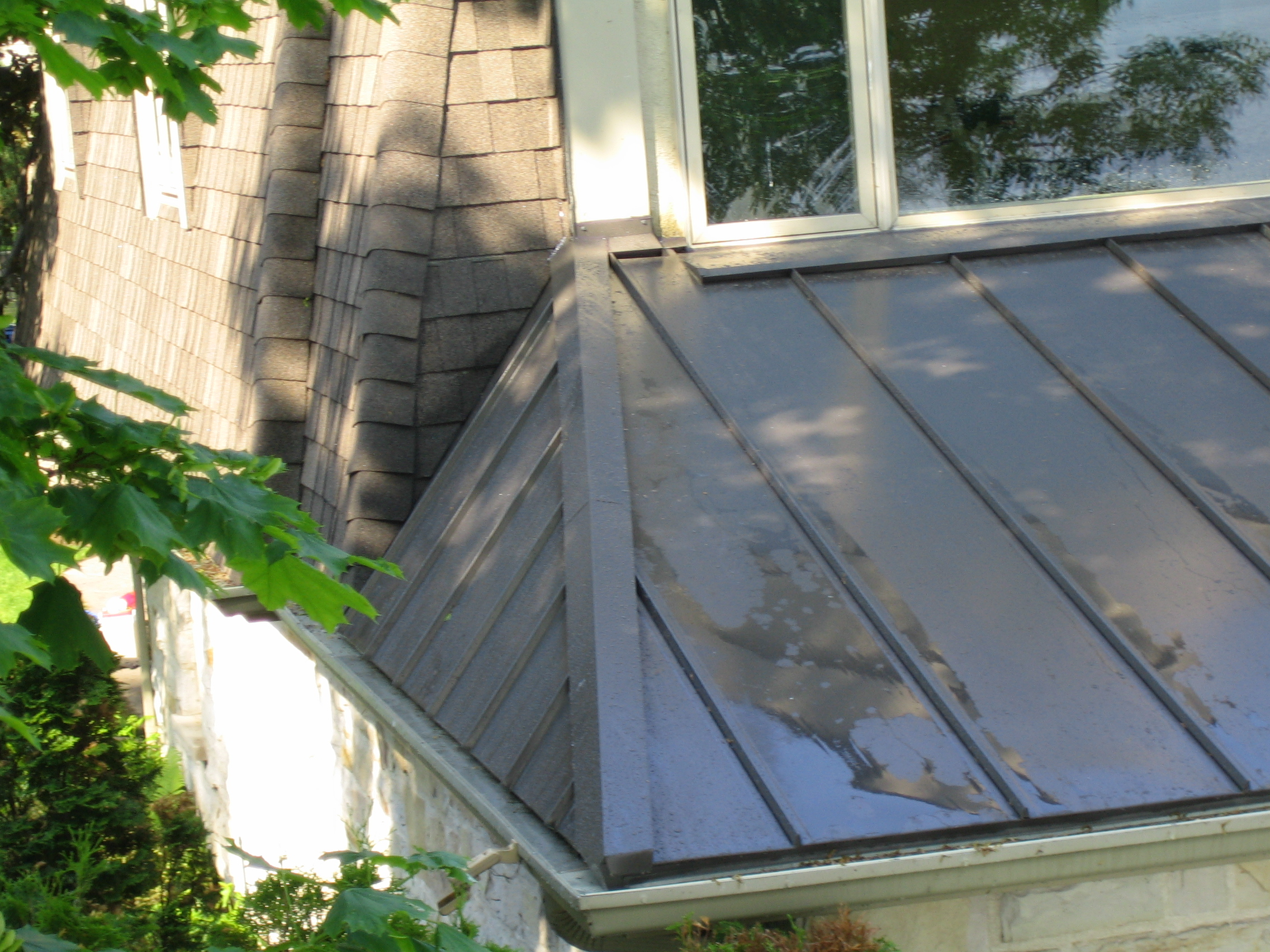 Metal roof hip section mackey metal roofing for Metal hip roof